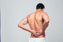 Portrait of a man standing with back pain Stock Photography