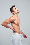 Portrait of a man standing with back pain Royalty Free Stock Photography