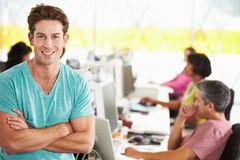 Portrait Of Man Standing In Busy Creative Office Royalty Free Stock Photo