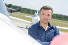 Portrait man stood next to aircraft. Portrait of man stood next to aircraft Stock Photos