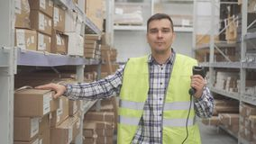 Portrait man store worker using bar code scanner scanning labels on boxes stock images