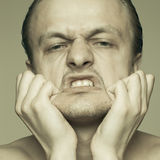 Portrait of man stretching his face Stock Photos