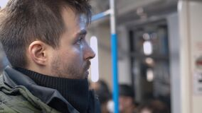Portrait of a man in subway car