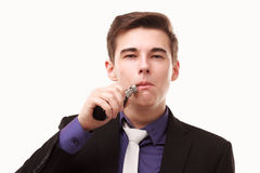 Portrait of a man in suit smoking an e-cigarette Stock Photo