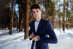 Portrait of a man in suit in snow forest Royalty Free Stock Images