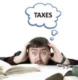 Portrait of a man is surprised about taxes with a cloud. Isolated royalty free stock images