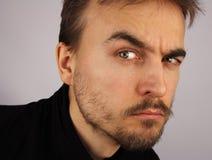 Portrait of a man, suspicious look, closeup Stock Photos