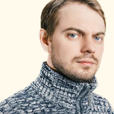 Portrait of a man in sweater. Isolated. Color toned image Stock Photos