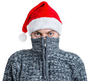 Portrait of a man in sweater. Portrait of a man in sweater with red Santa hat. Isolated on white Stock Photography
