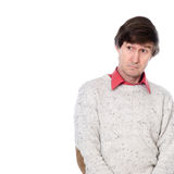 Portrait of a man in a sweater with a stupid look on his face. Royalty Free Stock Photography