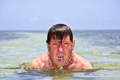 Portrait of a man swimming man Stock Images