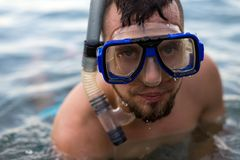 Portrait of a man in a swimming mask, close-up. diving. Portrait of a man in a swimming mask, close-up. Active lifestyle, diving attractive beach beautiful royalty free stock photography