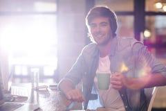 Portrait of man taking coffee break in office Royalty Free Stock Photography