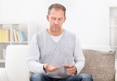Portrait of man taking pills Stock Photo