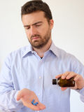 Portrait of a man taking  pills Royalty Free Stock Image
