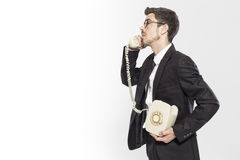 Portrait of a man talking on classic phone Stock Photography