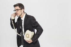 Portrait of a man talking on classic phone Stock Images