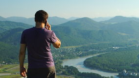 Portrait of Man talking on a mobile phone, Altai stock video