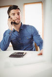 Portrait of man talking on phone Stock Photography