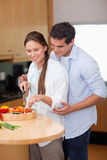 Portrait of a man teaching how to cook to his wife Stock Image