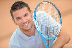 Portrait man with tennis racket Royalty Free Stock Photo