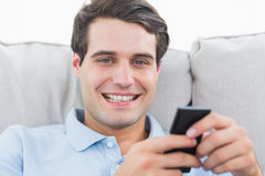 Portrait of a man text messaging with his phone Stock Images