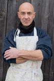 Portrait of Man in Thick Clothing and White Apron royalty free stock photography