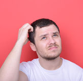 Portrait of man thinking against red background Royalty Free Stock Images