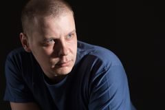 Portrait of a man. Of thirty years in a blue t-shirt royalty free stock photography