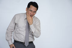 Portrait of man with toothache, Unhappy Asians man having a toothache. Sad man having toothache and touching cheek,Portrait of man with toothache, Unhappy Asians royalty free stock photos