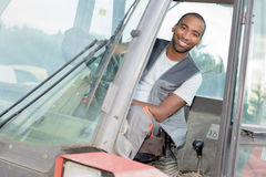 Portrait man in tractor cab Royalty Free Stock Image