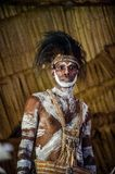 Portrait of a man from the tribe of Asmat people on Asmat Welcoming ceremony. Stock Photos