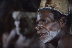 Portrait of a man from the tribe of Asmat people with ritual face painting on Asmat Welcoming ceremony. Stock Image
