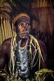 Portrait of a man from the tribe of Asmat people. Stock Photos