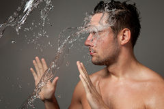 Portrait of a man under the water jets Stock Photo
