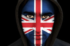 Portrait of a man with union jack flag face paint Stock Photo