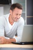 Portrait of man using computer Stock Image