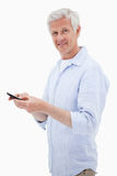 Portrait of a man using his mobile phone while looking at the ca Stock Image