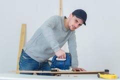 Portrait man using jigsaw Stock Photos