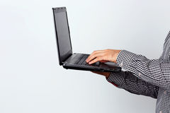 Portrait of a man using laptop Stock Photography