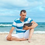 Portrait of man using tablet computer Stock Images