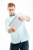 Portrait of man using tablet computer isolated on white background Royalty Free Stock Photography