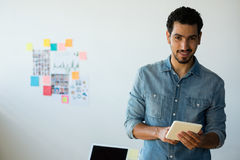 Portrait of man using tablet at office Royalty Free Stock Images