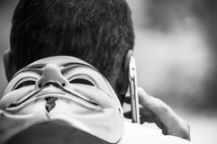 Portrait of man with Vendetta mask and telephone  in outdoor Stock Photos