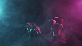 Portrait of a man in virtual reality helmet. Obscured dark face in VR goggles. Internet, darknet, gaming and cyber. Simulation concept stock video