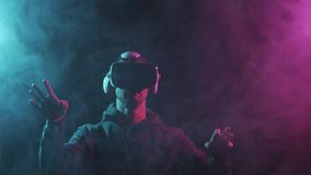 Portrait of a man in virtual reality helmet. Obscured dark face in VR goggles. Internet, darknet, gaming and cyber. Simulation concept stock video footage