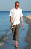 Portrait of man walking on a beach Stock Image