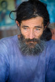 Portrait of the man of the wanderer. The person lives in a lodge which has constructed itself ashore, tea, Greece sells Royalty Free Stock Photos