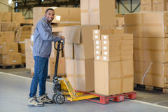 Portrait man in warehouse with pallet truck Royalty Free Stock Photos