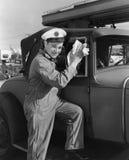 Portrait of man washing car windows Stock Photo